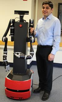 Professor George Konidaris and robot