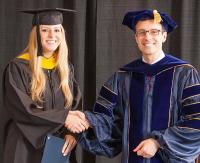 Chair presents award to undergrad student